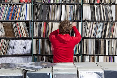A young man selecting a record from a shelf in a record store Stock Photo - Premium Royalty-Free, Code: 653-05976260