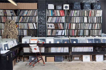 supermarket not people - A shopping cart and rows of records on shelves and in bins at a record store Stock Photo - Premium Royalty-Free, Code: 653-05976262