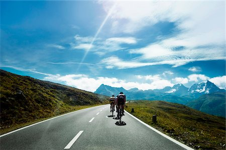 roads and sun - Cyclists on a mountain road, Tirol, Austria Stock Photo - Premium Royalty-Free, Code: 653-05976321