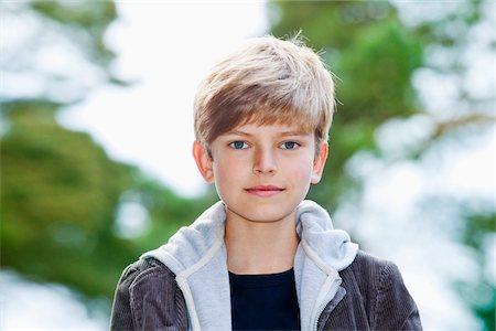 Portrait of a serious adolescent boy Stock Photo - Premium Royalty-Free, Code: 653-05976366