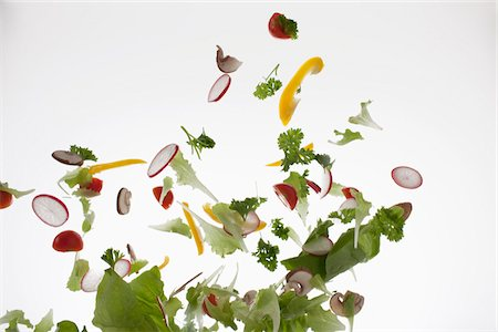 Salad against a white background Stock Photo - Premium Royalty-Free, Code: 653-05976401