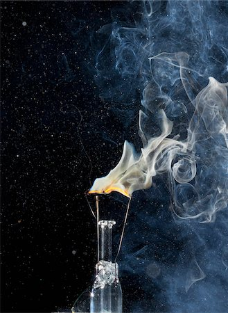 exploding - A light bulb filament on fire Stock Photo - Premium Royalty-Free, Code: 653-05976402