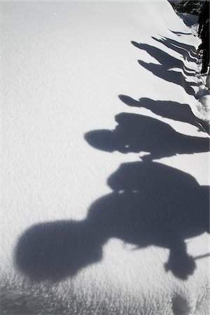 shadow - Shadows of hikers against a blanket of snow Stock Photo - Premium Royalty-Free, Code: 653-05976442