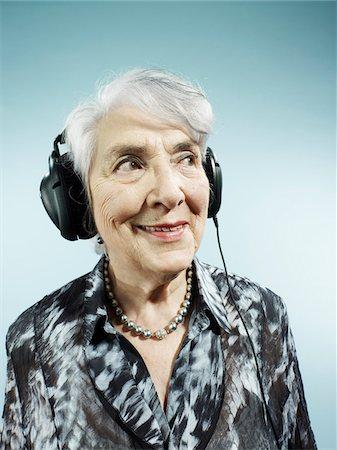 A senior woman wearing headphones Stock Photo - Premium Royalty-Free, Code: 653-05976472