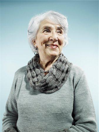 An elegant senior woman smiling and looking away Stock Photo - Premium Royalty-Free, Code: 653-05976519