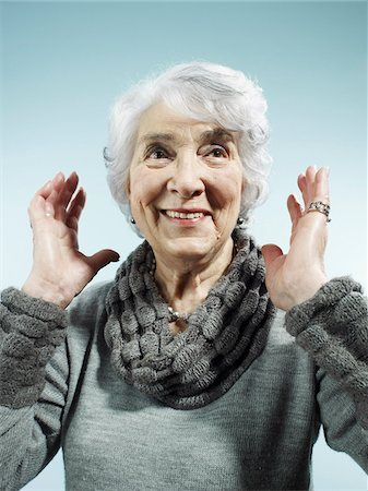 A senior woman with her arms raised in surprise Stock Photo - Premium Royalty-Free, Code: 653-05976547