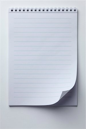 page - A spiral notepad with lined paper and a curled up page corner Stock Photo - Premium Royalty-Free, Code: 653-05976596