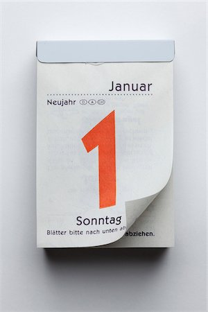 page - A German daily calendar showing New Year's Day with curled up page corner Stock Photo - Premium Royalty-Free, Code: 653-05976591