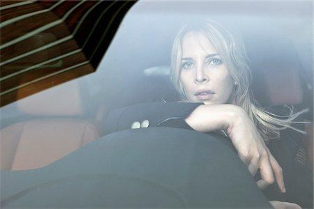 remote car - Pensive woman driving Stock Photo - Premium Royalty-Free, Code: 653-05976606