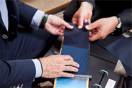 Detail of two men holding fabric samples Stock Photo - Premium Royalty-Free, Code: 653-05976665