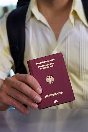 displaying - Detail of a man holding a German passport Stock Photo - Premium Royalty-Free, Code: 653-05976691