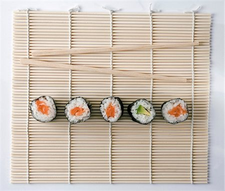 Sushi and chopsticks on a wooden mat Stock Photo - Premium Royalty-Free, Code: 653-05976744