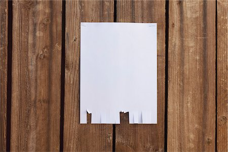 poster - A blank flyer hanging on a wooden fence Stock Photo - Premium Royalty-Free, Code: 653-05976768