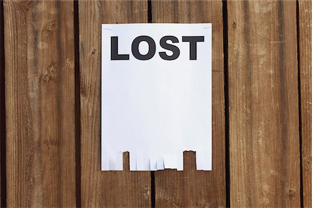 poster - A flyer posted on a wooden fence with the word LOST on it Stock Photo - Premium Royalty-Free, Code: 653-05976762