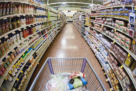 A shopping cart on an aisle in a supermarket, personal perspective Stock Photo - Premium Royalty-Free, Code: 653-05976770