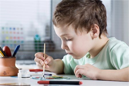 Boy Painting in workshop Stock Photo - Premium Royalty-Free, Code: 653-05976879