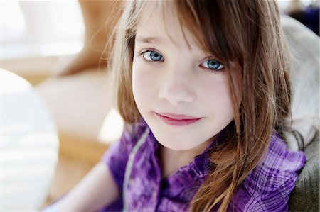 preteen girls faces photo - A young girl looking serenely into the camera Stock Photo - Premium Royalty-Free, Code: 653-06534065