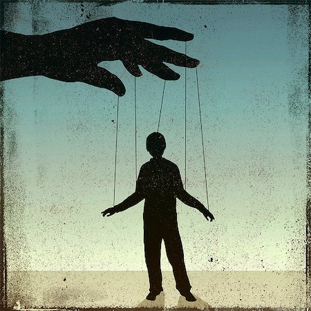 restrained - A silhouetted man being controlled by a puppeteer Stock Photo - Premium Royalty-Free, Code: 653-06534176