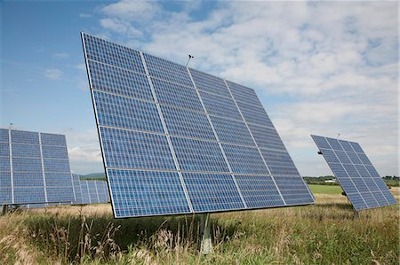 Solar panels in a field Stock Photo - Premium Royalty-Free, Code: 653-06534199