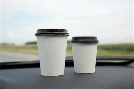 Two disposable cups of coffee on a car dashboard Stock Photo - Premium Royalty-Free, Code: 653-06534204