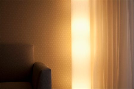 Detail of a light, sofa and curtain in a living room Stock Photo - Premium Royalty-Free, Code: 653-06534202