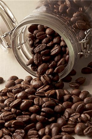 Detail of coffee beans spilling from a jar Stock Photo - Premium Royalty-Free, Code: 653-06534246