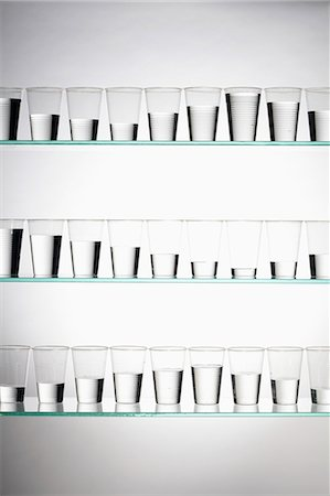 Rows of glasses filled with varying amounts of water Stock Photo - Premium Royalty-Free, Code: 653-06534324