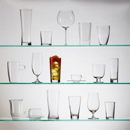 stage show - One glass filled with bubble tea placed amongst a collection of empty drinking glasses Stock Photo - Premium Royalty-Free, Code: 653-06534325