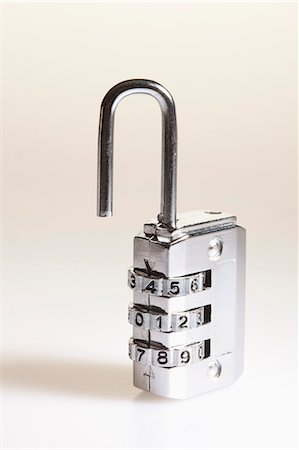 Combination padlock Stock Photo - Premium Royalty-Free, Code: 653-06534338