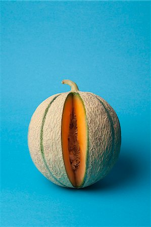 represented - A cantaloupe with a slice removed Stock Photo - Premium Royalty-Free, Code: 653-06534367