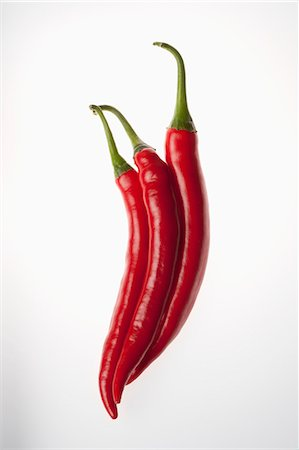 represented - Three red chili peppers touching, in a row Stock Photo - Premium Royalty-Free, Code: 653-06534368