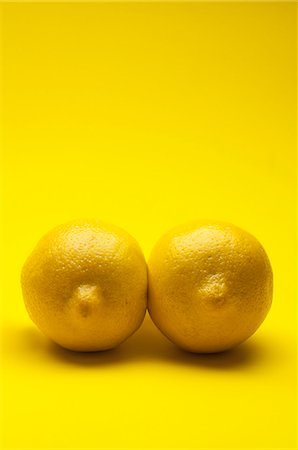 represented - Two lemons arranged to look like a pair of breasts Stock Photo - Premium Royalty-Free, Code: 653-06534375