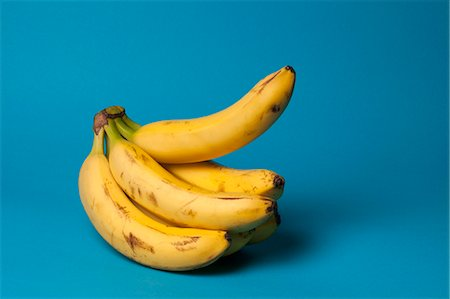 represented - A bunch of bananas with one banana sticking up, suggestive of an erection Stock Photo - Premium Royalty-Free, Code: 653-06534376