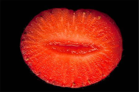represented - A suggestively shaped cross section of a strawberry Stock Photo - Premium Royalty-Free, Code: 653-06534380