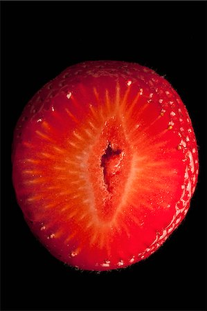 represented - A suggestively shaped cross section of a strawberry Stock Photo - Premium Royalty-Free, Code: 653-06534397