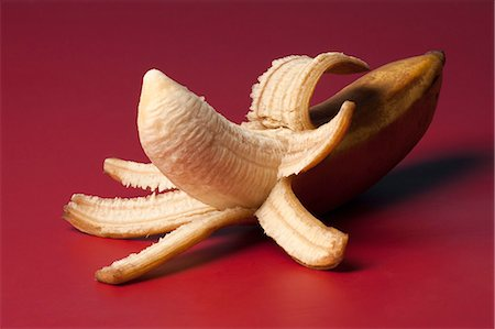 represented - A peeled banana suggestive of an erect penis Stock Photo - Premium Royalty-Free, Code: 653-06534392