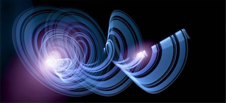 design (motif, artistic composition or finished product) - Light trails creating an abstract blue spiral pattern on a black background Stock Photo - Premium Royalty-Free, Code: 653-06534445