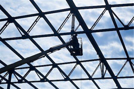 Welder on crane welding roof beam Stock Photo - Premium Royalty-Free, Code: 653-06534490
