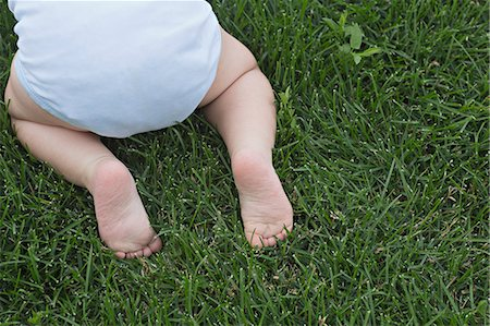 Baby in garden Stock Photo - Premium Royalty-Free, Code: 653-06534568
