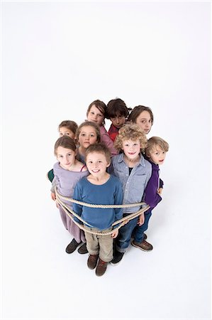 restrained - A group of kids tied together with a rope Stock Photo - Premium Royalty-Free, Code: 653-06534809