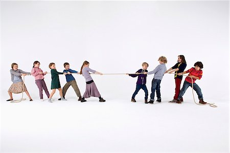 pulling - A group of kids playing tug-of-war Stock Photo - Premium Royalty-Free, Code: 653-06534823