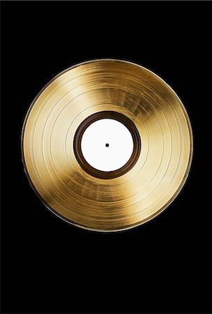 A gold record on a black background Stock Photo - Premium Royalty-Free, Code: 653-06534934