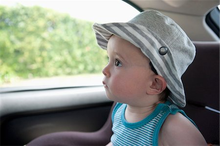 A child anticipating a car ride, sitting in car seat Stock Photo - Premium Royalty-Free, Code: 653-06534960