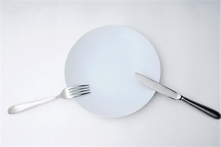 Knife, fork and plate Stock Photo - Premium Royalty-Free, Code: 653-06534987