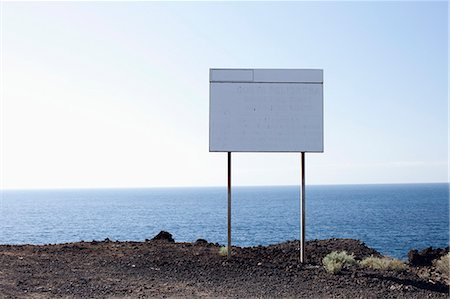 A blank billboard next to the sea Stock Photo - Premium Royalty-Free, Code: 653-06535034