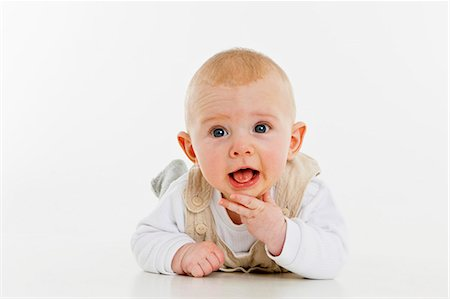 A baby boy lying on his front Stock Photo - Premium Royalty-Free, Code: 653-06533626