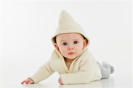 Portrait of a baby boy lying on his stomach Stock Photo - Premium Royalty-Free, Code: 653-06533654