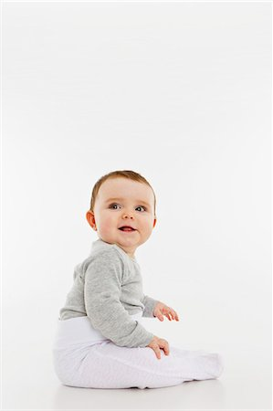Portrait of a baby girl sitting Stock Photo - Premium Royalty-Free, Code: 653-06533653