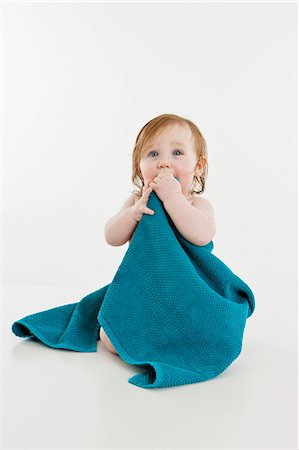 A baby girl wrapped in a towel Stock Photo - Premium Royalty-Free, Code: 653-06533662