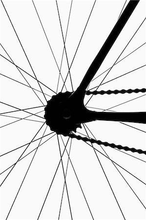 Detail of a bicycle wheel, back lit, studio shot Stock Photo - Premium Royalty-Free, Code: 653-06533829